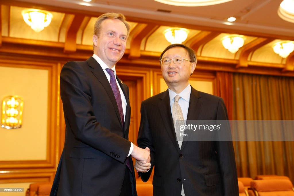 Norway Foreign Minister Borge Brende shakes hands with Chinese State Councilor Yang Jiechi ahead of a meeting in Zhongnanhai Leadership Compound on April 10, 2017 in Beijing, China.