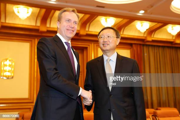 Norway Foreign Minister Borge Brende shakes hands with Chinese State Councilor Yang Jiechi ahead of a meeting in Zhongnanhai Leadership Compound on...