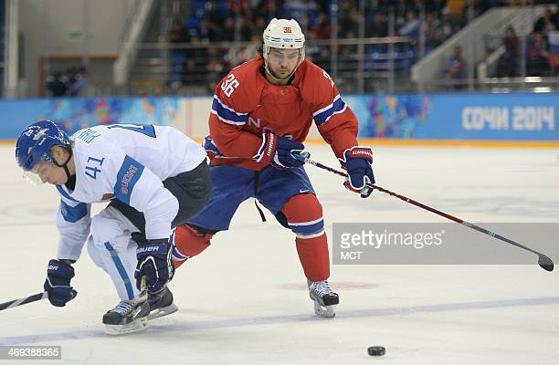 Norway forward Mats Zuccarello works the puck past Finland forward Antti Pihlstrom during the first period at Shayba Arena during Winter Olympics in...