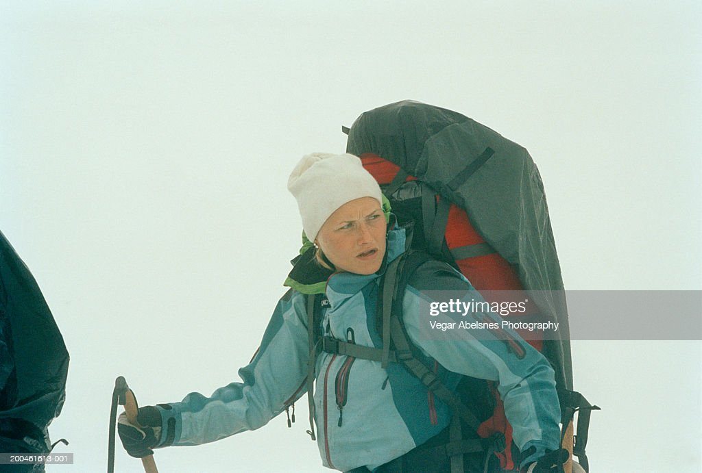 Norway, Jotunheimen, woman Randonee skiing, looking over shoulder : Stock Photo