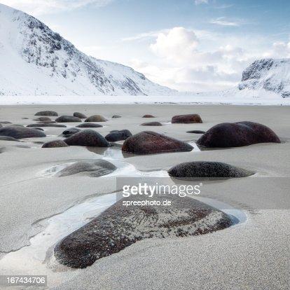 Norway lofoten unstad beach with stones : Stock Photo