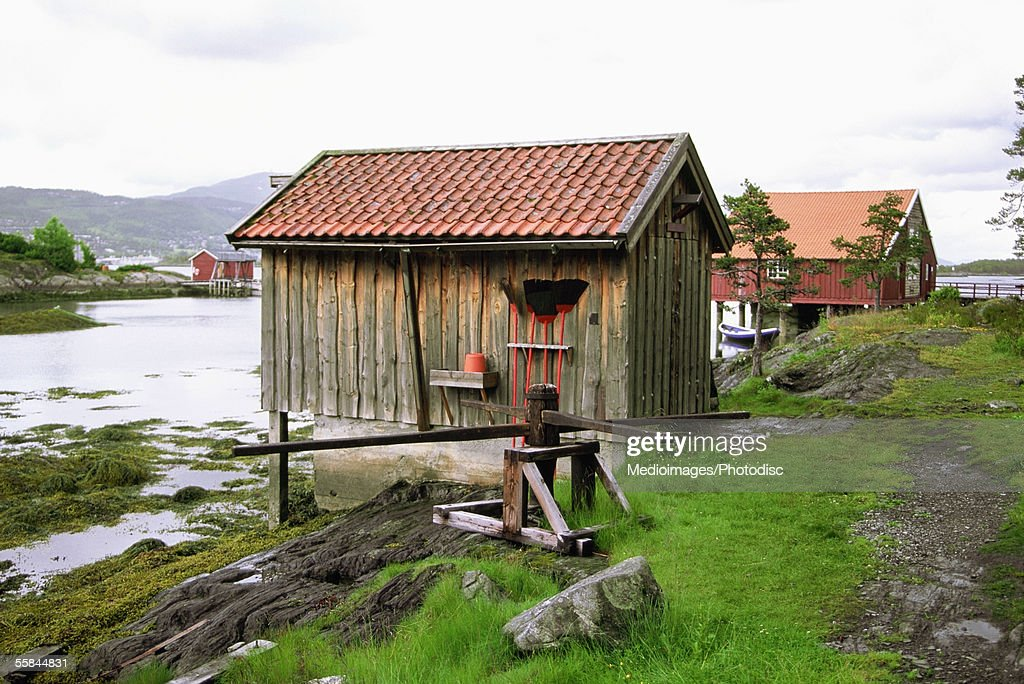 Norway, Molde, Hjertoya Island, Smoke house on the bank of a river : Stock Photo