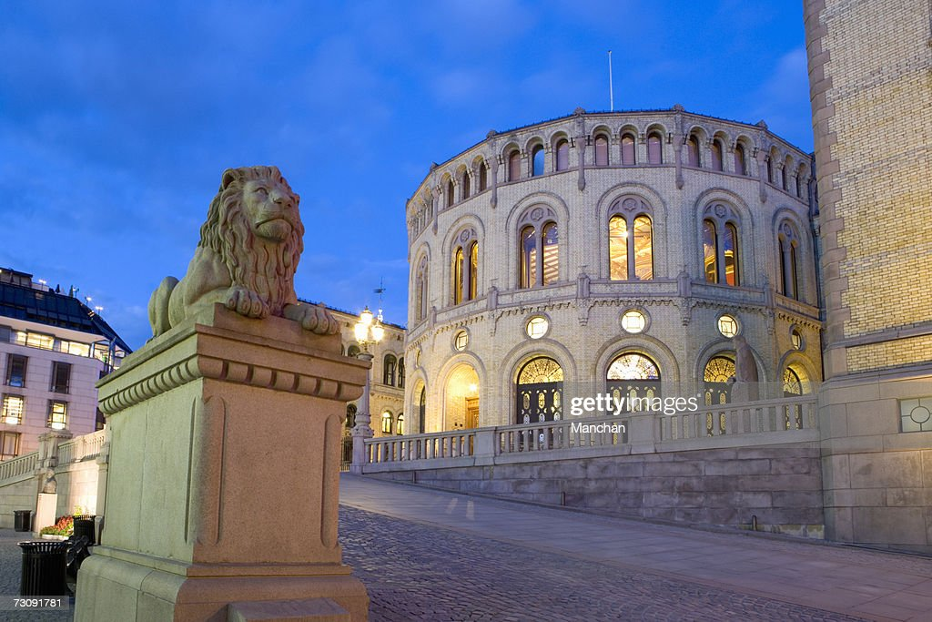Norway, Oslo, Lion statue in street by parliament buildings