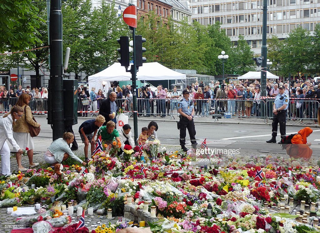OSLO Norway People offer flowers near a cathedral in Oslo Norway on July 24 2011 The cathedral held a mass the same day to mourn the dozens of...