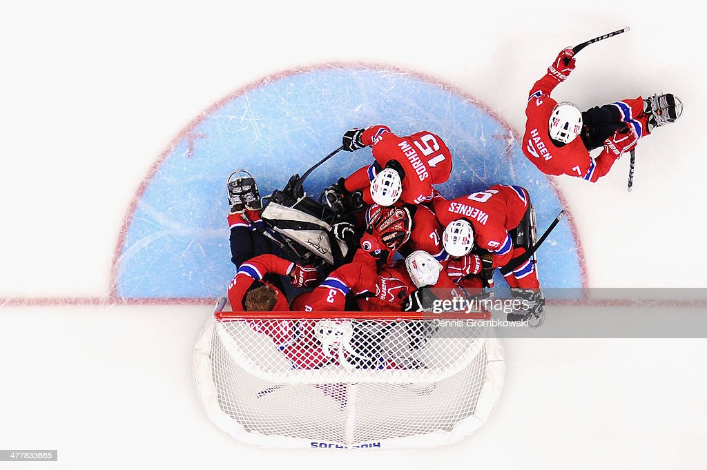 Norway players celebrate after the Ice Sledge Hockey Preliminary Round Group A match between Norway and Sweden during day four of Sochi 2014 Paralympic Winter Games at Shayba Arena on March 11, 2014 in Sochi, Russia.
