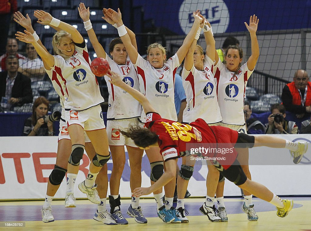 Norway players try to block shoot of Milena Knezevic of Montenegro (R) during the Women's European Handball Championship 2012 gold medal match between Norway and Montenegro at Arena Hall on December 16, 2012 in Belgrade, Serbia.