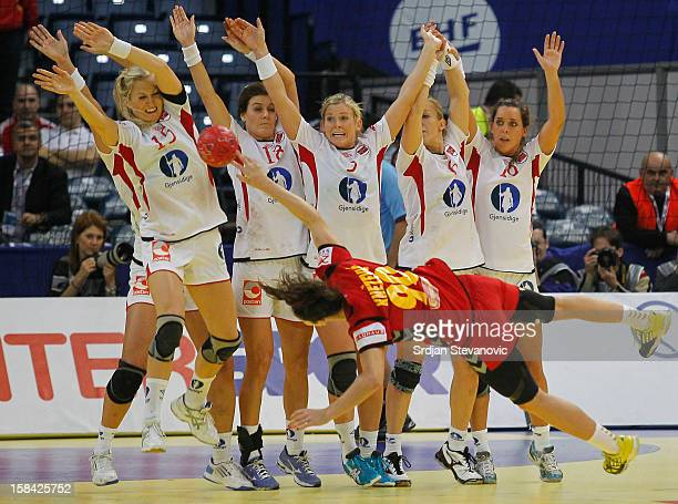 Norway players try to block shoot of Milena Knezevic of Montenegro during the Women's European Handball Championship 2012 gold medal match between...