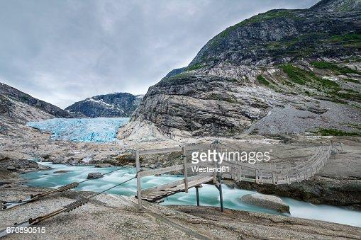 Norway, Sogn og Fjordane, Jostedalsbreen National Park, Nigardsbreen, Glacier tongue, suspension bridge