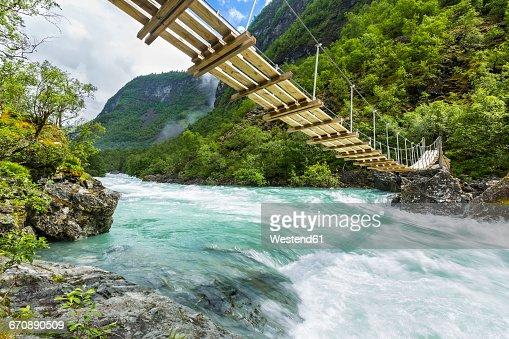Norway, Sogn og Fjordane, Utla river and suspension bridge