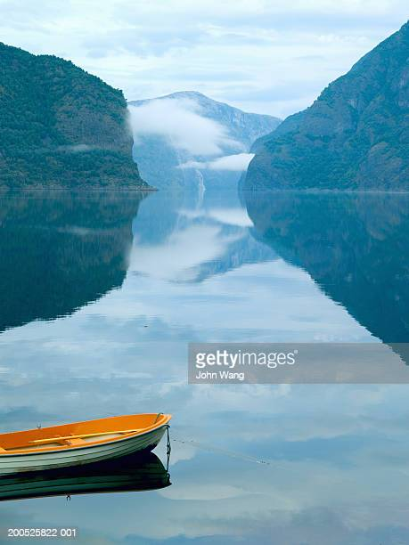 Norway, Sognefjord, Aurland, rowboat in fjord at dawn, elevated view