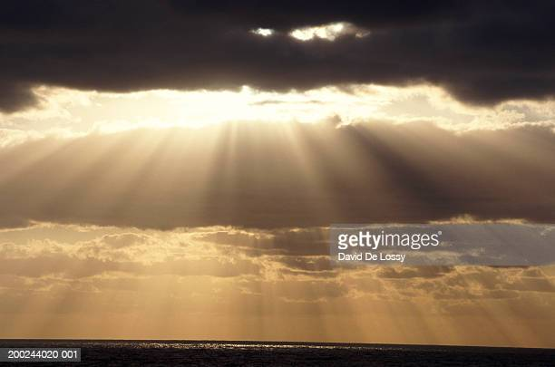 Norway, sunbeams shining through stormy clouds, golden