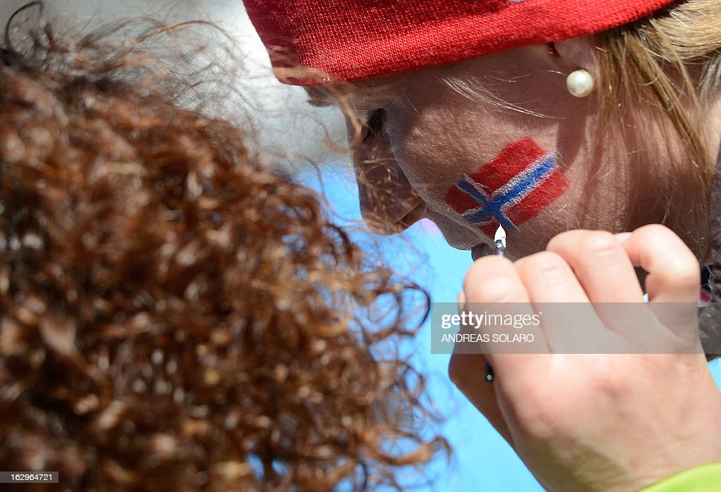 A Norway supporter has her face painted with the Norwegian flag on March 2, 2013 before the Women's Cross Country 30 km Classic race of the FIS Nordic World Ski Championships at Val Di Fiemme Cross Country stadium in Cavalese, northern Italy. AFP PHOTO / ANDREAS SOLARO