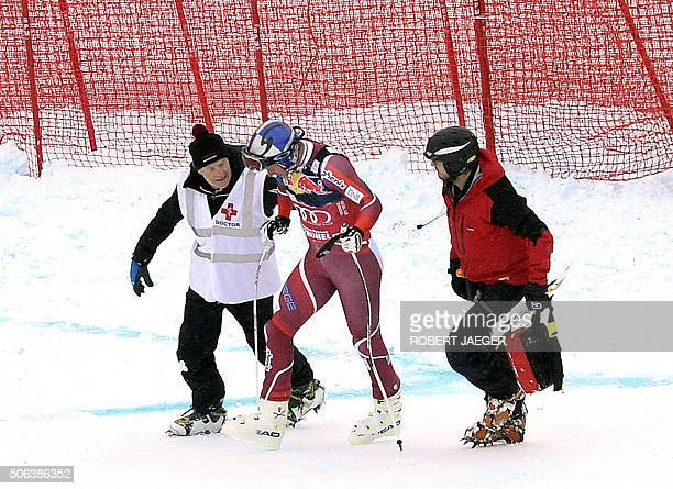 Norway's Aksel Lund Svindal is helped by medical staff after crashing during the men's downhill race of the FIS Alpine Skiing World Cup in Kitzbuehel...