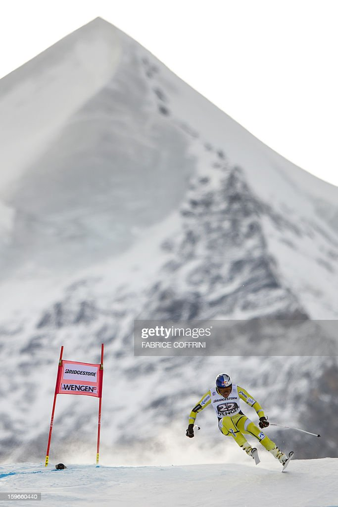 Norway's Aksel Lund Svindal leaps on January 18, 2013 in front of the Silberhorn mountain during the downhill event of the men's super combined of the FIS Alpine Skiing World Cup in Wengen.