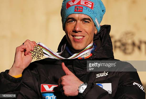 Norway's Anders Bardal poses with his gold medal on the podium at the medals ceremony of the men's small hill ski jumping of the FIS Nordic World Ski...