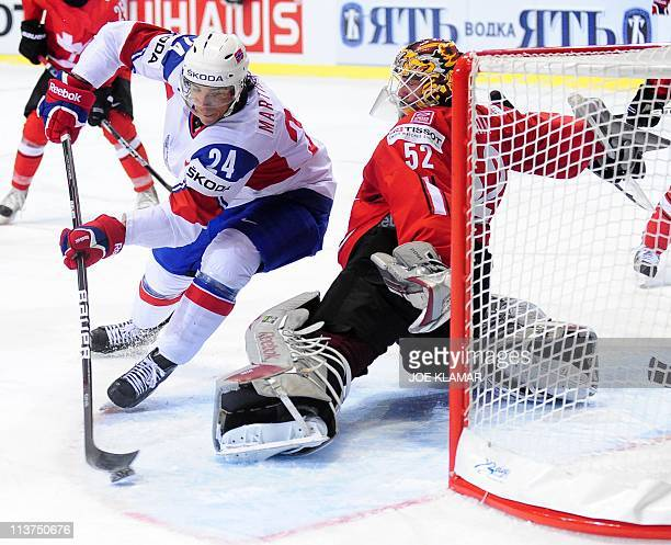 Norway's Andreas Martinsen tries for a chance on goal but fails to score past Swiss goalie Tobias Stephan during their IIHF Ice Hockey World...