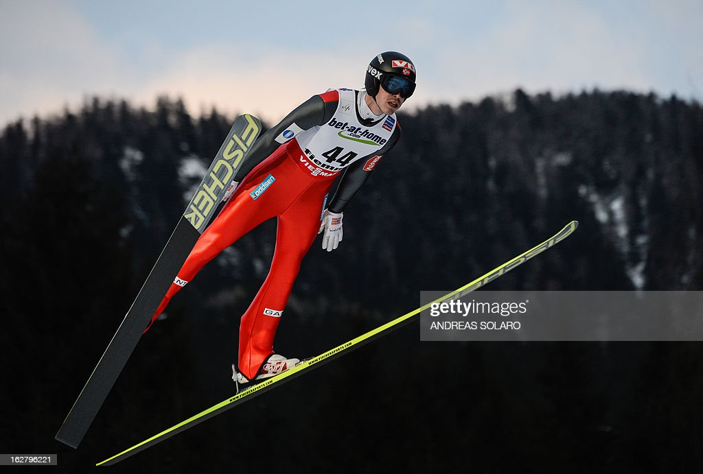 Norway's Andreas Stjernen soars through the air on February 27, 2013 during the Large Hill Individual qualification race of the FIS Nordic World Ski Championships at the Ski Jumping stadium in Predazzo, northern Italy. AFP PHOTO / ANDREAS SOLARO