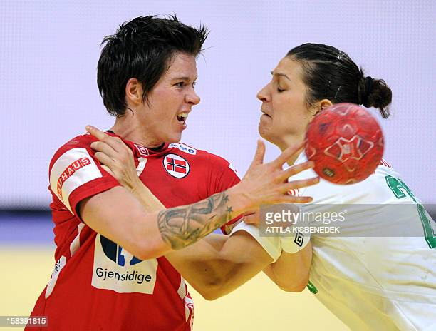 Norway's Anja Edin is pushed by Hungary's Klara Szekeres during the 2012 EHF European Women's Handball Championship semifinal match on December 15 at...