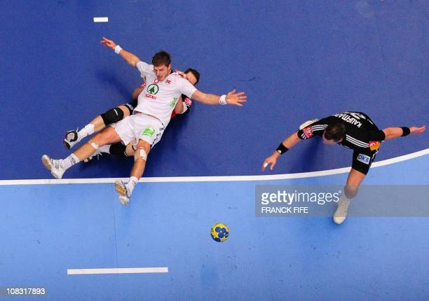 Norway's Bjarte Myrhol vies with Germany's Sebastian Preiss during their 22nd men's Handball World Championships match Germany versus Norway at the...