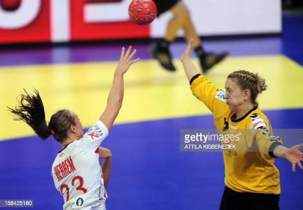 Norway's Camilla Herrem scores a goal past Montenegro's goalkeeper Sonja Barjaktarovic during the 2012 EHF European Women's Handball Championship...