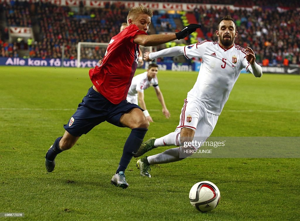 Norway's captain Per Ciljan Skjelbred and Hungary's defender Attila Fiola vie for the ball during the firstleg play off qualifier football match for...