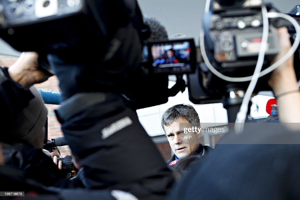 Norway's CEO of Statoil, Helge Lund, answers questions during a press conference on Januaray 19, 2013, as he arrives at the drop-in center in Bergen, Norway for relatives of the Statoil-employees taken hostages in Algeria. Two Norwegians have been found alive but six others remain unaccounted for in the hostage crisis at a gas field in Algeria, Norway's Statoil said Saturday. AFP PHOTO / ANETTE KARLSEN, SCANPIX NORWAY / NORWAY OUT