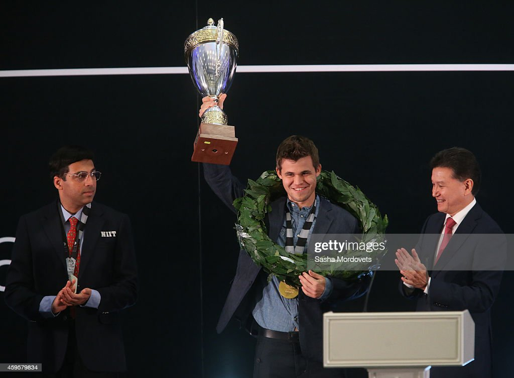 Norway's Chess Grandmaster <a gi-track='captionPersonalityLinkClicked' href=/galleries/search?phrase=Magnus+Carlsen&family=editorial&specificpeople=2602660 ng-click='$event.stopPropagation()'>Magnus Carlsen</a> (C), FIDE President <a gi-track='captionPersonalityLinkClicked' href=/galleries/search?phrase=Kirsan+Ilyumzhinov&family=editorial&specificpeople=2020049 ng-click='$event.stopPropagation()'>Kirsan Ilyumzhinov</a> (R) and Indian Chess Grandmaster Wiswanathan Anand (L) attend the World Championship Chess Match November 25, 2014 in Sochi, Russia. Vladimir Putin congratulated <a gi-track='captionPersonalityLinkClicked' href=/galleries/search?phrase=Magnus+Carlsen&family=editorial&specificpeople=2602660 ng-click='$event.stopPropagation()'>Magnus Carlsen</a> who became the World Chess Champion in the match against Wiswanathan Anand.