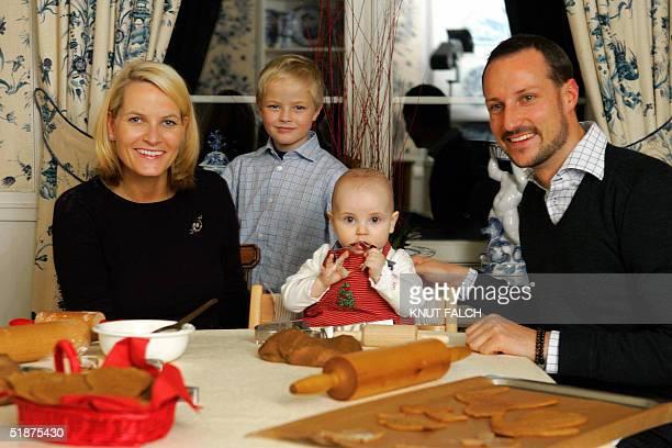 Norway's Crown Princess MetteMarit her son Marius Princess Ingrid Alexandra and Crown Prince Haakon prepare Christmas cakes in their home Skaugum in...