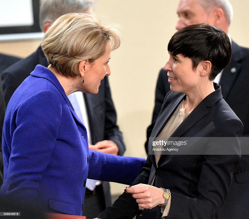 Norway's Defence Minister Ine Marie Eriksen Soreide (R) and Albanian Defense Minister Mimi Kodheli (L) speak to each other prior to the start of a NATO Defence Ministers meeting at the NATO headquarter in Brussels, Belgium on February 10, 2016.