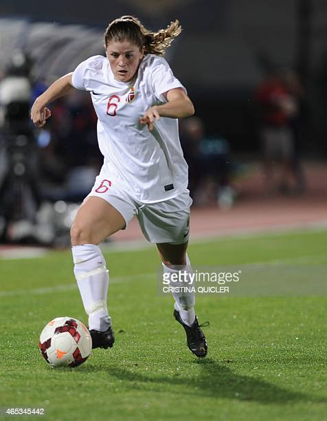 Norway's defender Maren Mjelde runs with the ball during the Algarve Cup football match Norway vs USA at the Estadio Municipal in Vila Real de Santo...