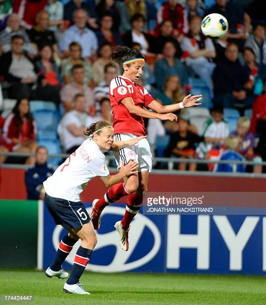 Norway's defender Toril Akerhaugen and Denmark's forward Nadia Nadim vie for the ball during the UEFA Women's European Championship Euro 2013 semi...