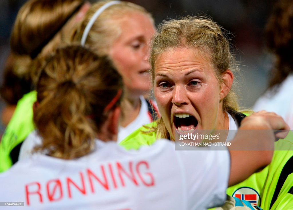 Norway's defender Trine Ronning (L) and goalkeeper Ingrid Hjelmseth celebrate after winning the penalty shootout of the UEFA Women's European Championship Euro 2013 semi final football match Norway vs Denmark on July 25, 2013 in Norrkoping, Sweden. Norway won the match 4-2 after penalties and will face Germany in the final on July 28, 2013.