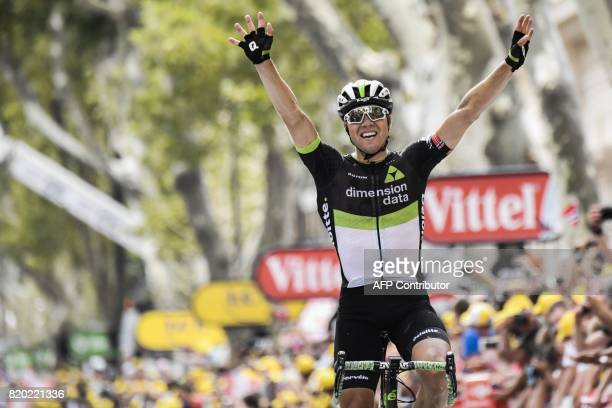 TOPSHOT Norway's Edvald Boasson Hagen celebrates as he crosses the finish line at the end of the 2225 km nineteenth stage of the 104th edition of the...