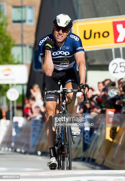 Norway's Edvald Boasson Hagen crosses the finish line to win the 1624 km 4th stage of the Tour des Fjords between Stavanger and Sandnes in Norway on...