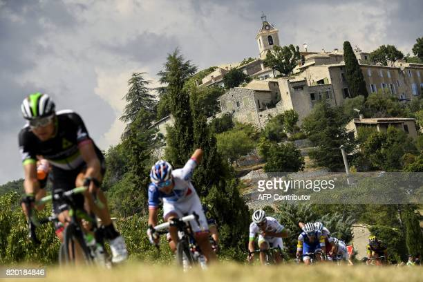 TOPSHOT Norway's Edvald Boasson Hagen rides in a breakaway near a village during the 2225 km nineteenth stage of the 104th edition of the Tour de...
