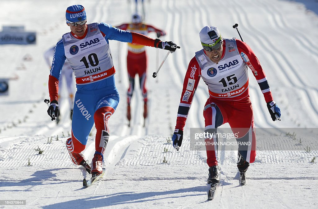 Norway's Eldar Roenning (R) crosses the finish line to win over Russia's Maxim Vylegzhanin (L) during the FIS Cross-Country World Cup Men 15 km Classic Mass Start in Falun, on March 23, 2013.