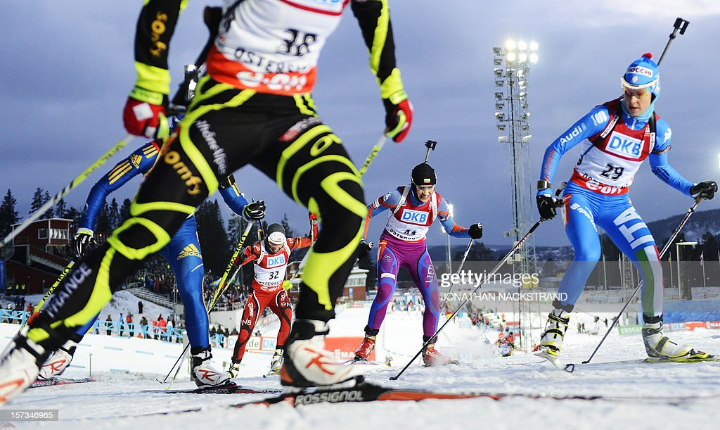 Norway's Elise Ringen, Lithuania's Diana Rasimoviciute and Italy's Michela Ponza compete during the Women 10km Pursuit race of the Biathlon World Cup in Ostersund on December 2, 2012.
