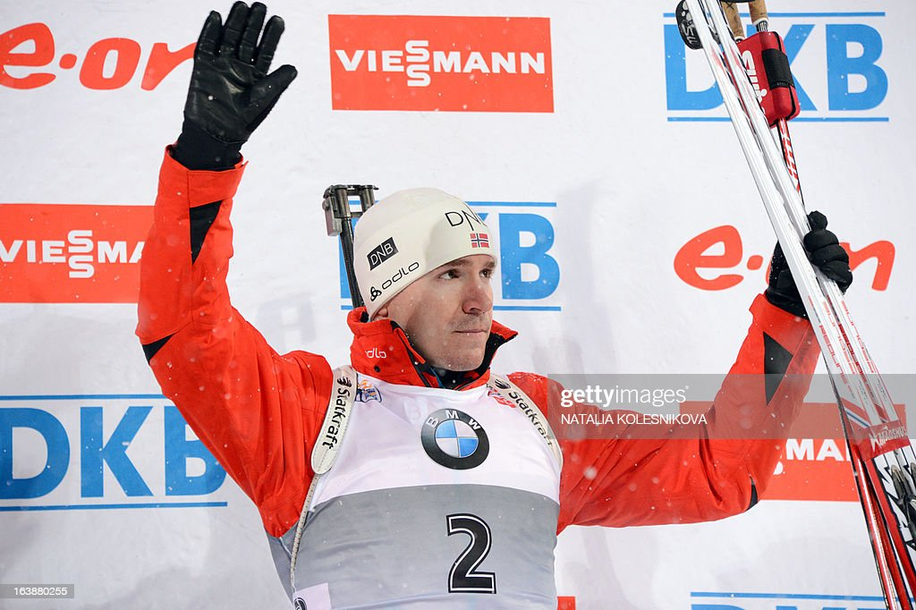 Norway's Emil Hegle Svendsen celebrates on the podium after winning third place in the men's 15 km mass start event of the IBU Biathlon Word Cup in the Siberian city of Khanty-Mansiysk, on March 17, 2013. France's Martin Fourcade took the first place ahead of Austria's Dominik Landertinger and Norway's Emil Hegle Svendsen.