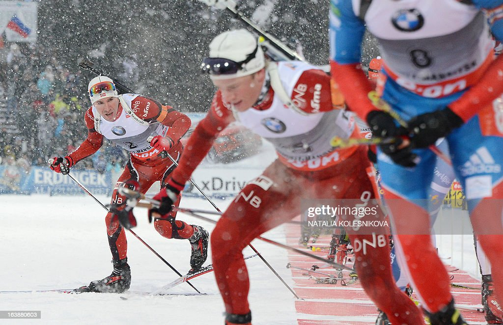 Norway's Emil Hegle Svendsen (L) leaves the shooting range during the men's 15 km mass start event of the IBU Biathlon Word Cup in the Siberian city of Khanty-Mansiysk, on March 17, 2013. France's Martin Fourcade took first place ahead of Austria's Dominik Landertinger and Norway's Emil Hegle Svendsen. AFP PHOTO/NATALIA KOLESNIKOVA