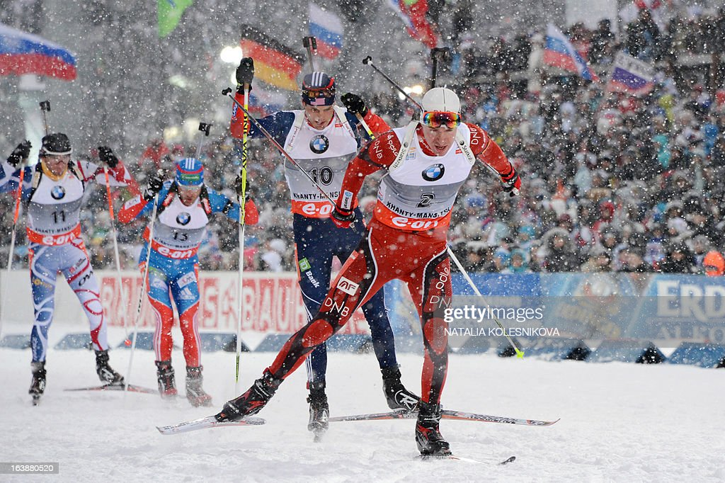 Norway's Emil Hegle Svendsen (R) races to place third in the men's 15 km mass start event of the IBU Biathlon Word Cup in the Siberian city of Khanty-Mansiysk, on March 17, 2013. France's Martin Fourcade took first place ahead of Austria's Dominik Landertinger and Norway's Emil Hegle Svendsen.