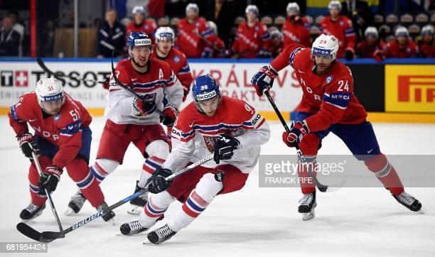 Norway's forward Andreas Martinsen vies with Czech Republic's forward Daniel Sorvik during the IIHF Men's World Championship group B ice hockey match...