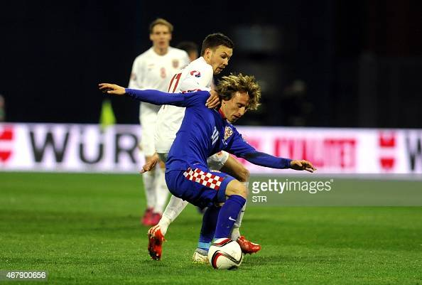 Norway's forward Martin Linnes vies with Croatia's midfielder Luka Modric during the Euro 2016 qualifying football match between Croatia and Norway...