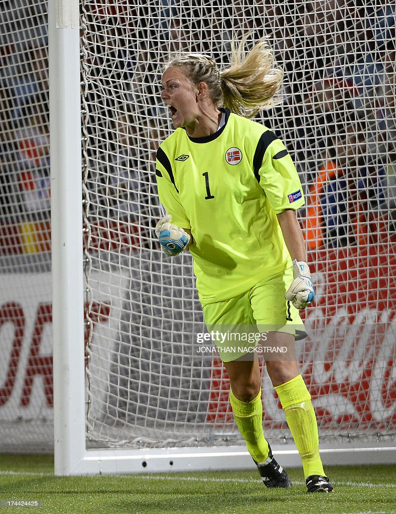 Norway's goalkeeper Ingrid Hjelmseth celebrates after making a save during the penalty shootout of the UEFA Women's European Championship Euro 2013 semi final football match Norway vs Denmark on July 25, 2013 in Norrkoping, Sweden. Norway won the match 4-2 after penalties and will face Germany in the final on July 28, 2013. AFP PHOTO/JONATHAN NACKSTRAND