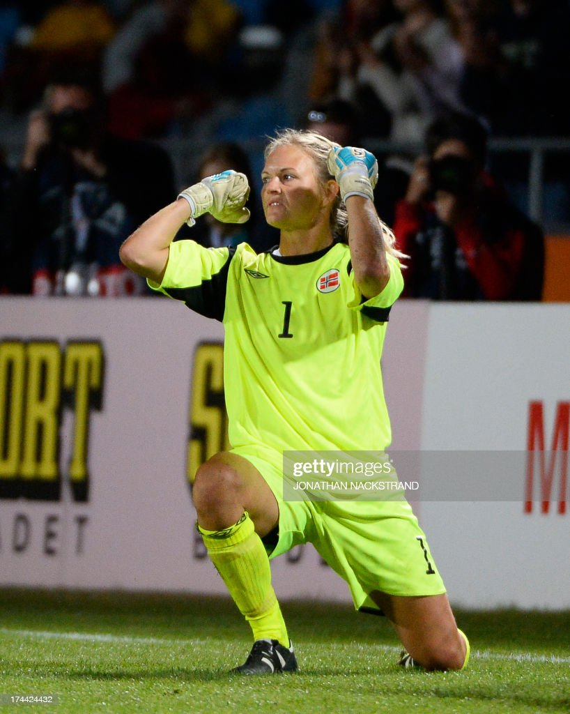 Norway's goalkeeper Ingrid Hjelmseth celebrates after making a save during the penalty shootout of the UEFA Women's European Championship Euro 2013 semi final football match Norway vs Denmark on July 25, 2013 in Norrkoping, Sweden. Norway won the match 4-2 after penalties and will face Germany in the final on July 28, 2013.
