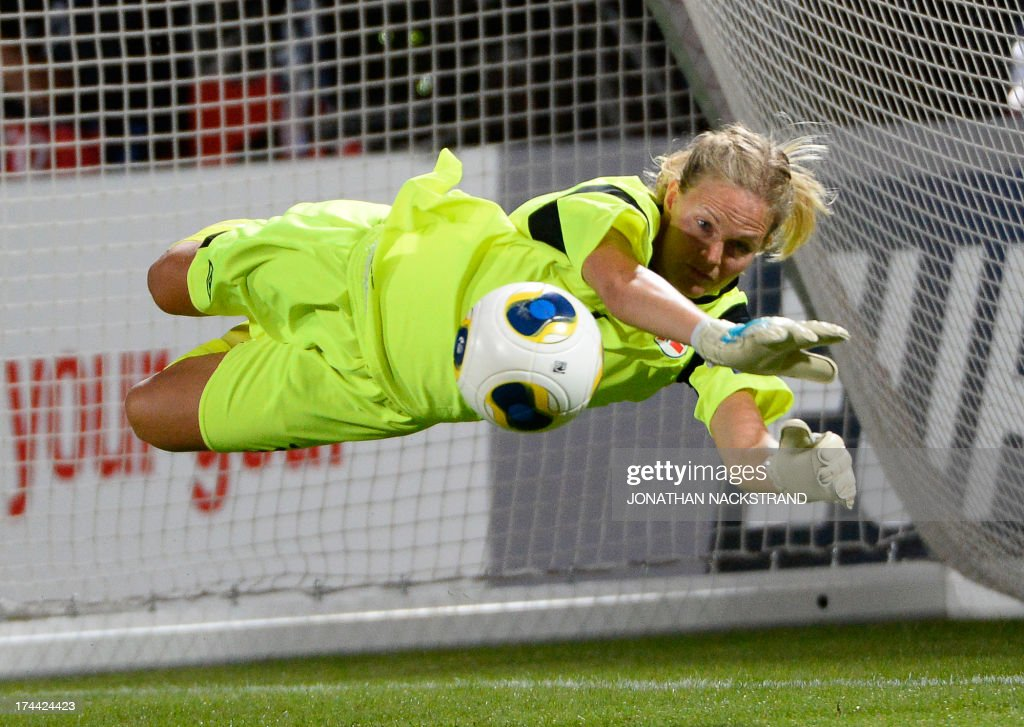 Norway's goalkeeper Ingrid Hjelmseth makes a save during the penalty shootout of the UEFA Women's European Championship Euro 2013 semi final football match Norway vs Denmark on July 25, 2013 in Norrkoping, Sweden. Norway won the match 4-2 after penalties and will face Germany in the final on July 28, 2013. AFP PHOTO/JONATHAN NACKSTRAND