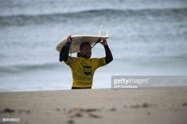 Norway's Havard Anensen walks to the shore during the Lofoten Masters 2017 the world's most northerly surf competition in Unstad's bay in the arctic...