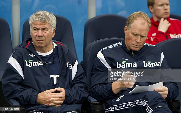 Norway's head coach Egil Olsen and Norway's assistant coach Ola By Riise follow the match during the EURO 2012 friendly football match Norway vs...