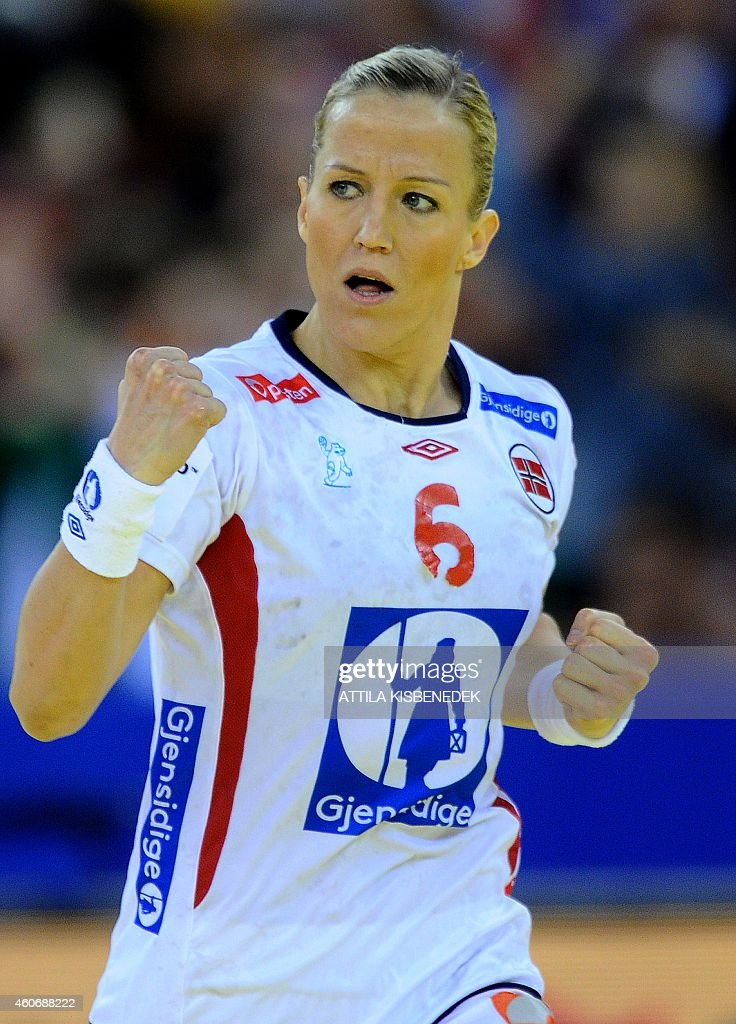 Norway's <a gi-track='captionPersonalityLinkClicked' href=/galleries/search?phrase=Heidi+Loke&family=editorial&specificpeople=6331820 ng-click='$event.stopPropagation()'>Heidi Loke</a> celebrates her score against Sweden in Papp Laszlo Arena of Budapest on December 19, 2014 during their semifinal match of Women's European Championships.