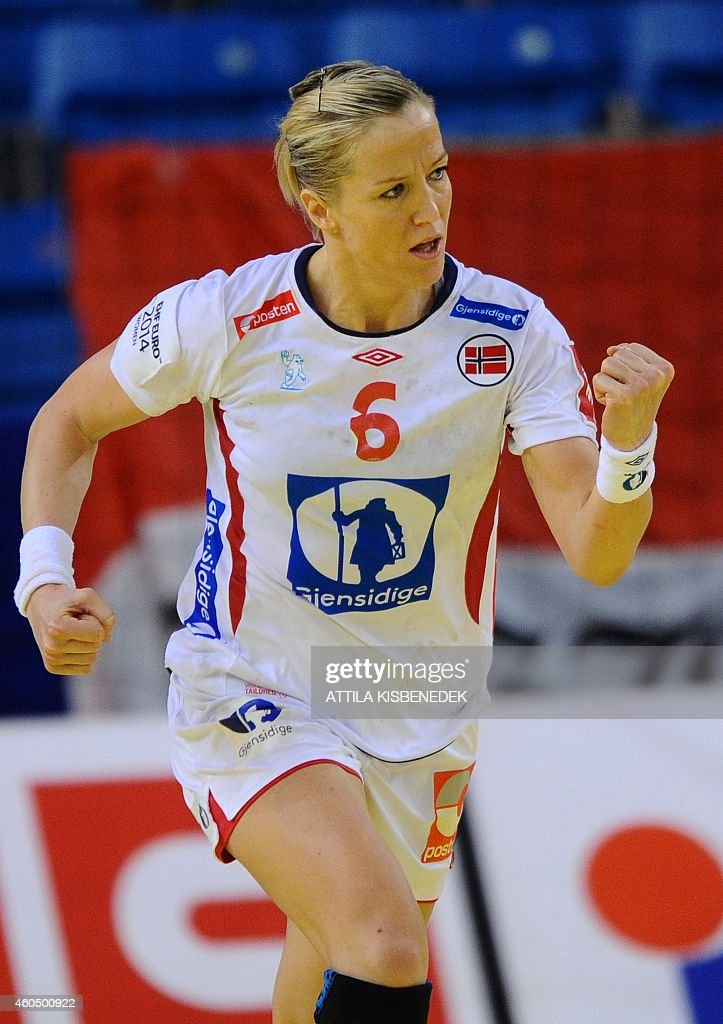 Norway's <a gi-track='captionPersonalityLinkClicked' href=/galleries/search?phrase=Heidi+Loke&family=editorial&specificpeople=6331820 ng-click='$event.stopPropagation()'>Heidi Loke</a> celebrates scoring during the Women's European Championships main round handball match Poland vs Norway at the Fonix Hall of Debrecen on December 15, 2014.