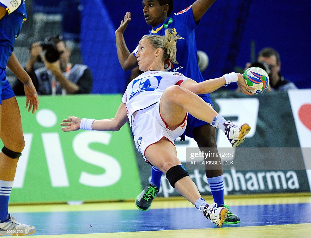 Norway's <a gi-track='captionPersonalityLinkClicked' href=/galleries/search?phrase=Heidi+Loke&family=editorial&specificpeople=6331820 ng-click='$event.stopPropagation()'>Heidi Loke</a> scores a goal against Sweden in Papp Laszlo Arena of Budapest on December 19, 2014 during their semifinal match of Women's European Championships.